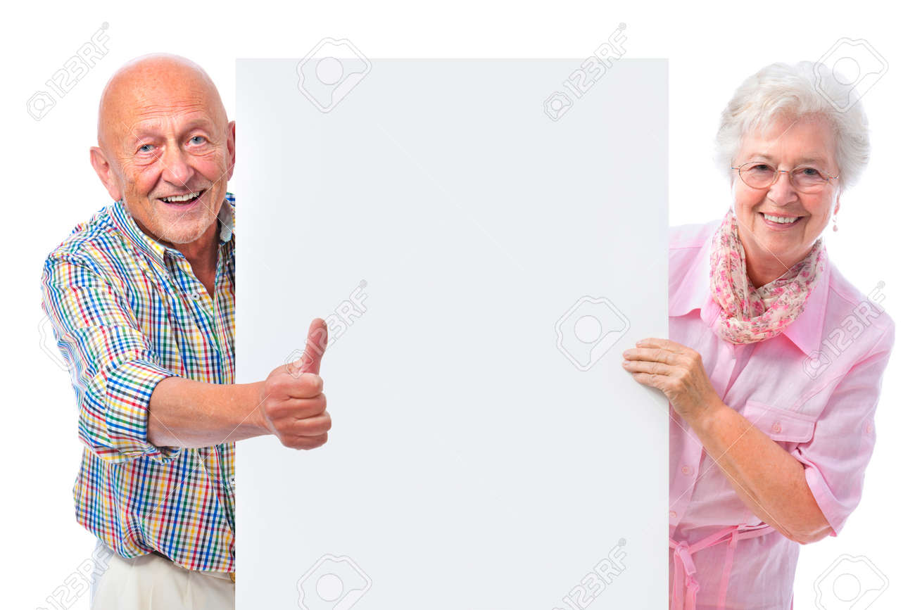 happy smiling senior couple holding a blank board isolated on white Stock Photo - 15785951