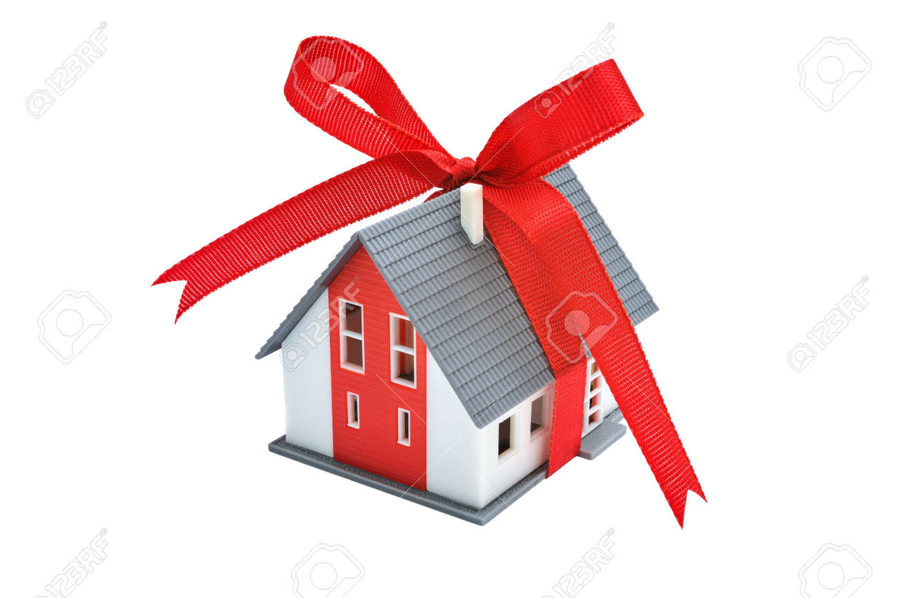 Gift- house. Model of a house with red ribbon Stock Photo - 18030876