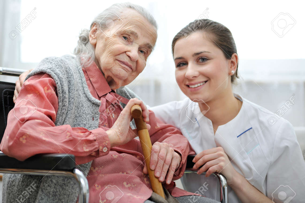 Senior woman with her caregiver at home Stock Photo - 18916070