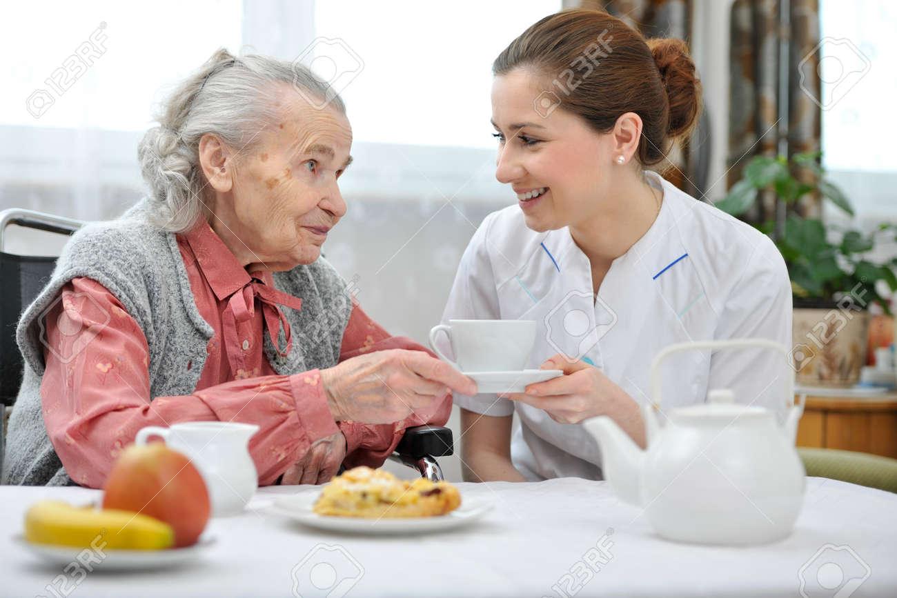 Senior woman eats lunch at retirement home Standard-Bild - 18916073