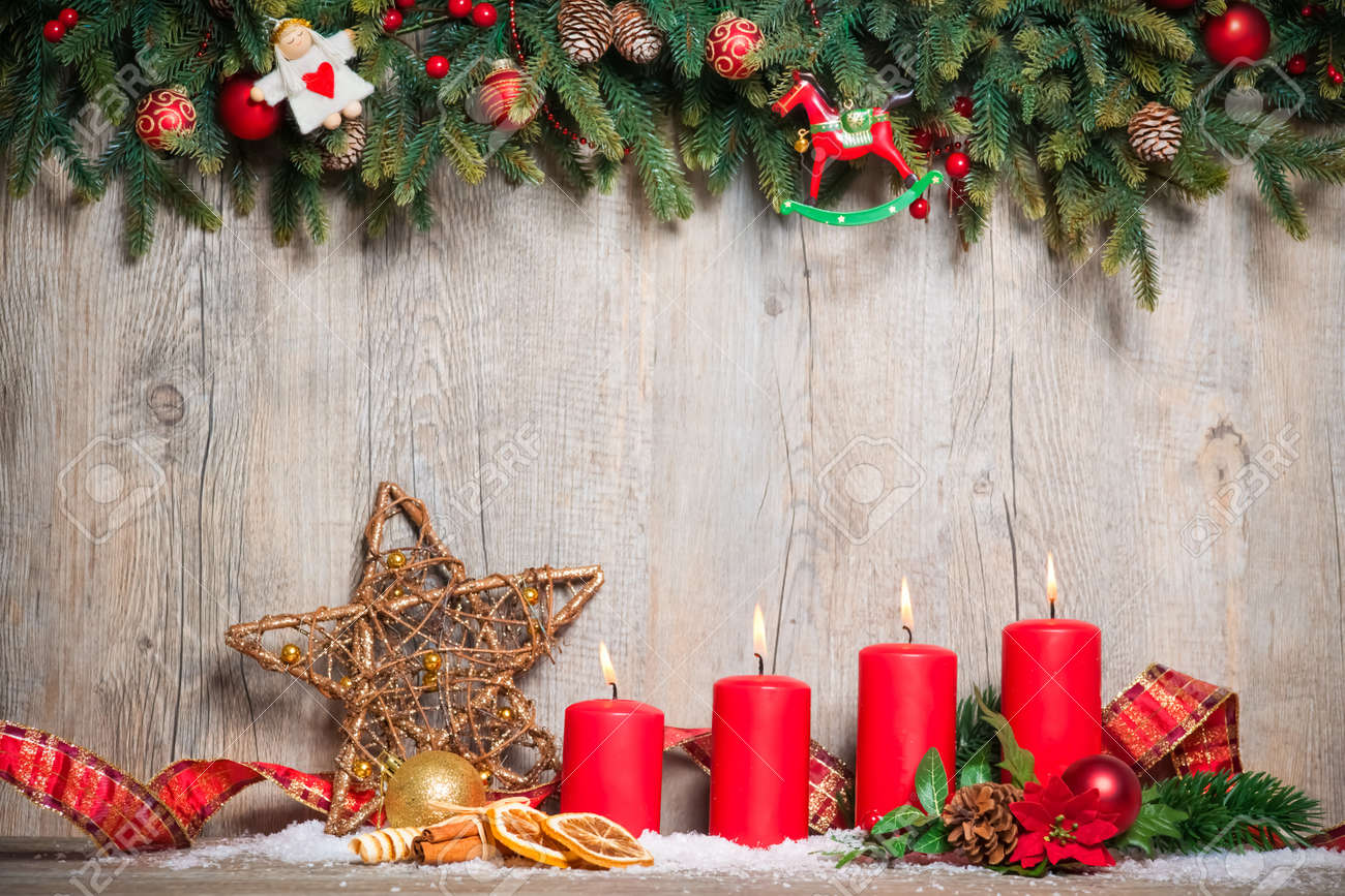 christmas decoration background with four advent candles burning Stock Photo - 21918580