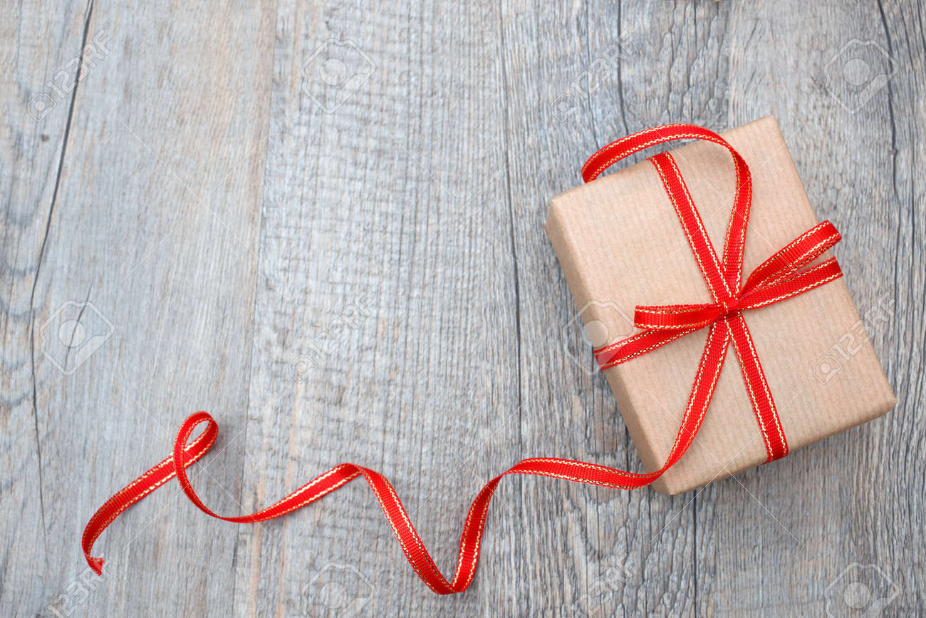Gift box with red bow on wood background stock photo picture and gift box with red bow on wood background stock photo 22215651 negle Images