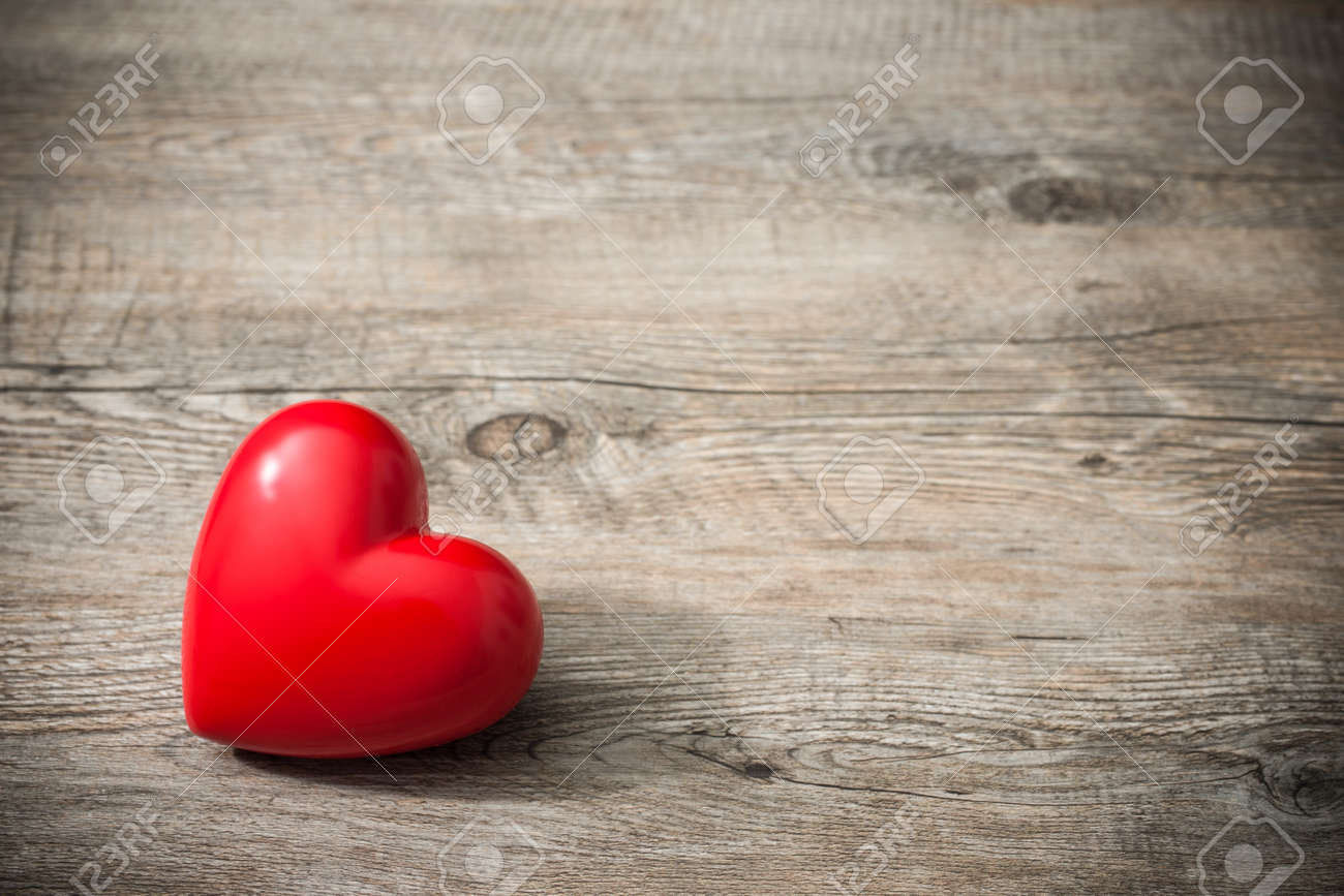red heart on wooden background valentines day background