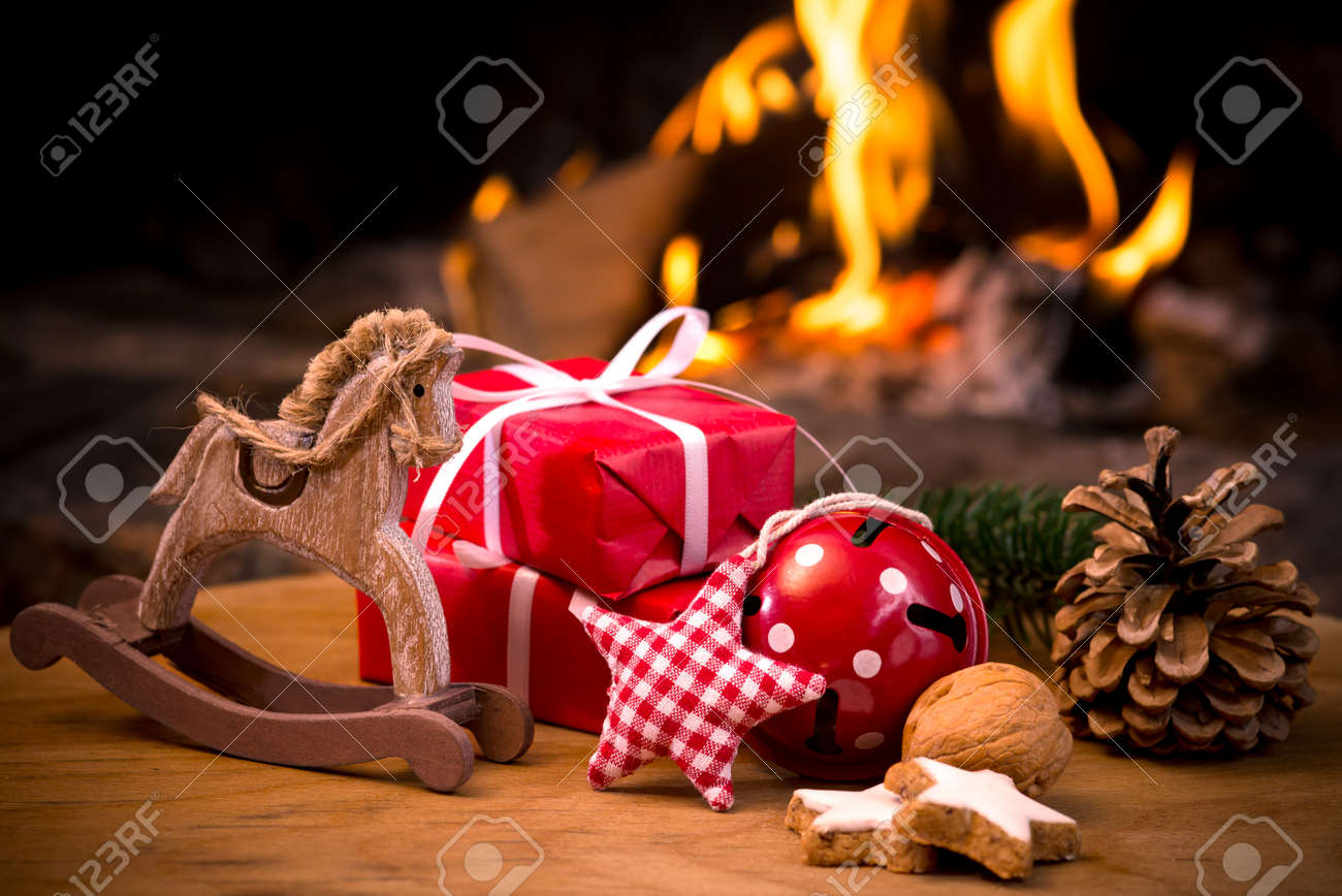Christmas scene with tree gifts and fire in background - 29766682