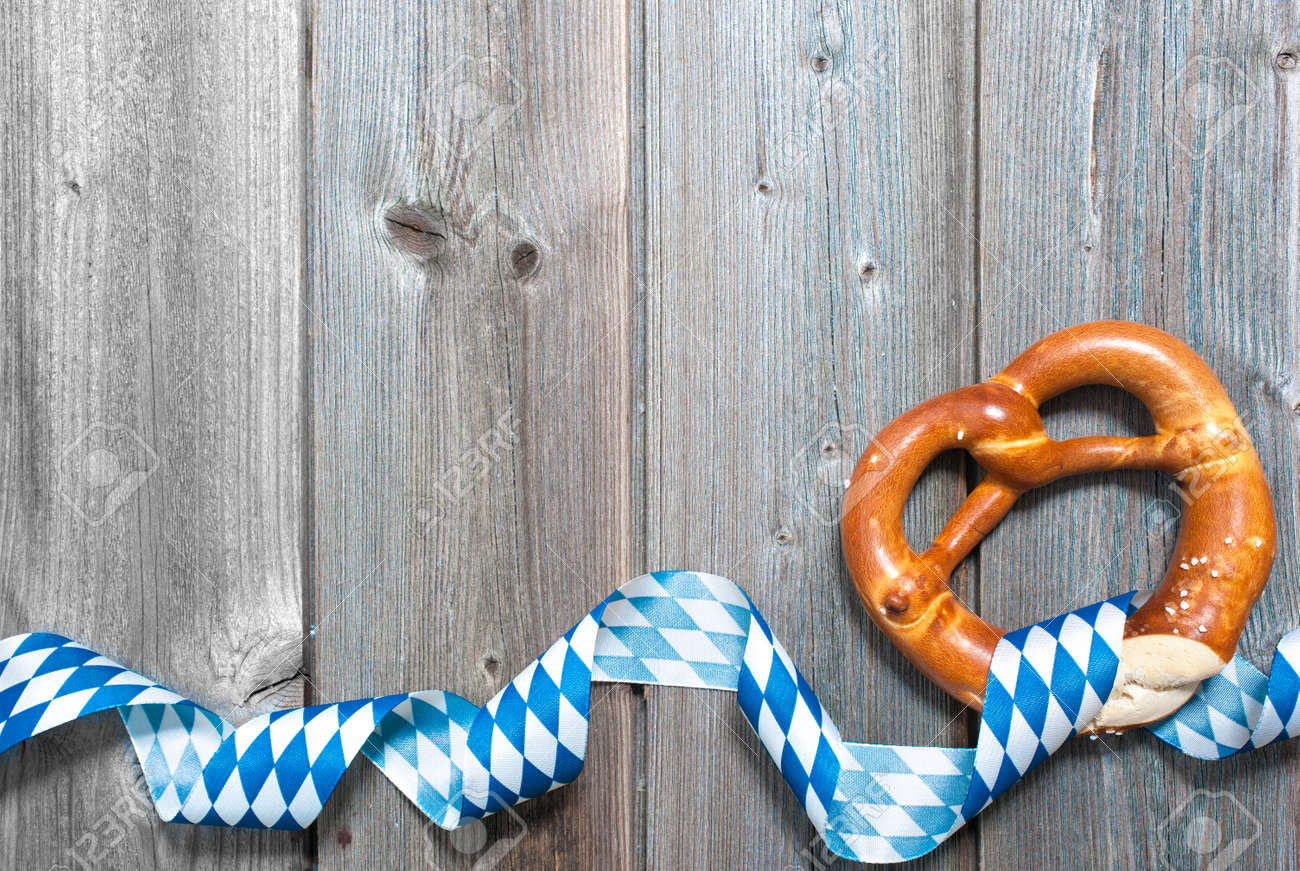 68e7e1d32ee Bavarian pretzels with ribbon on wooden board as a background for  Oktoberfest