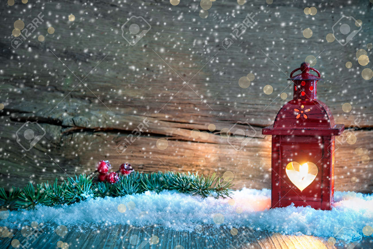 Christmas Background With Burning Lantern In The Snow Stock Photo