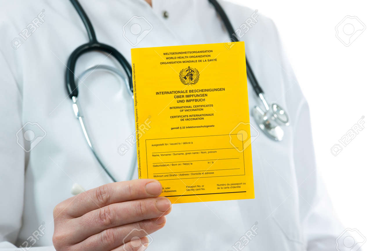 Doctor showing an international certificate of the vaccination - 37623503