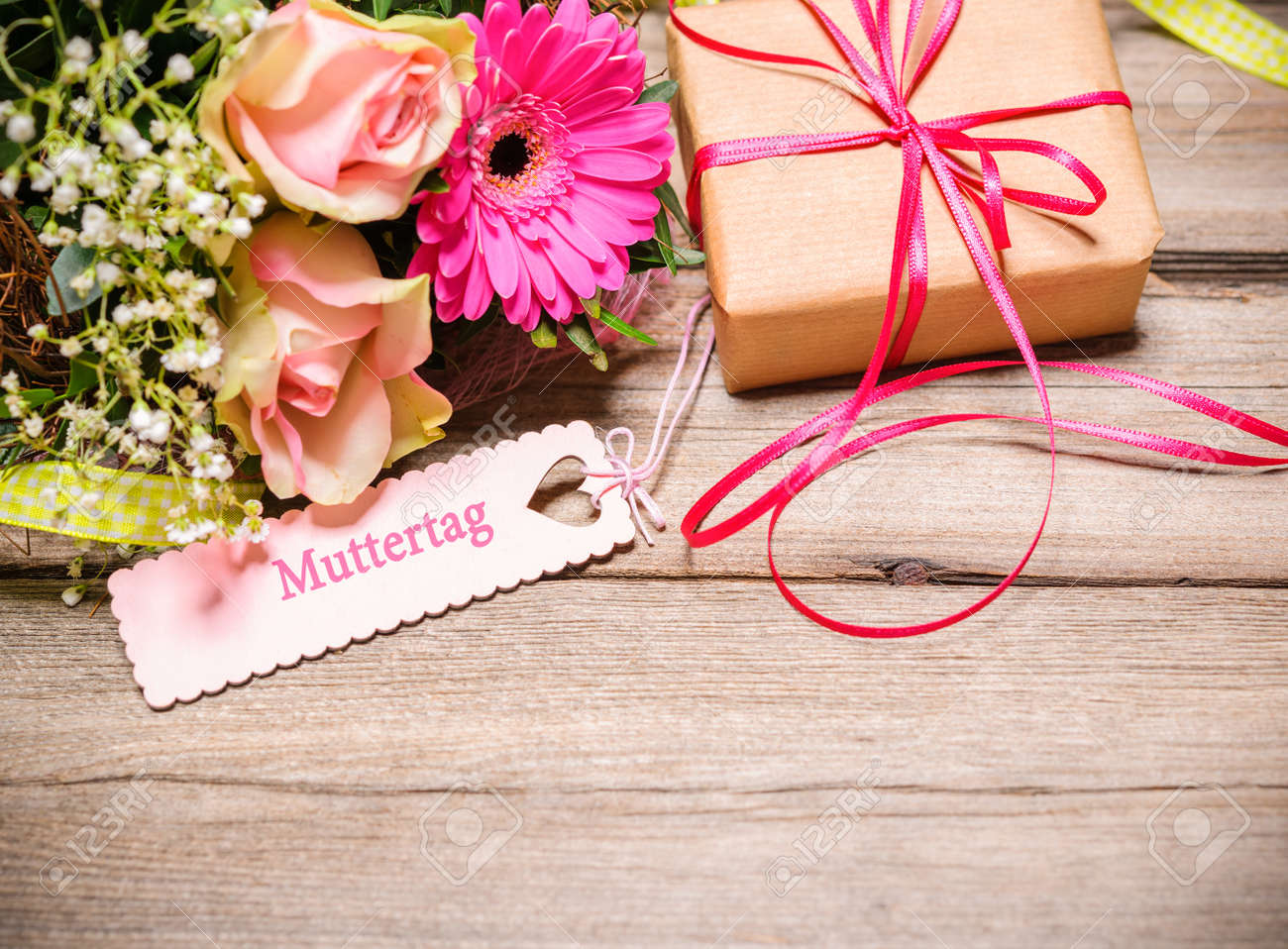 Bunch Of Flowers And Tag With German Text On Wooden Background ...
