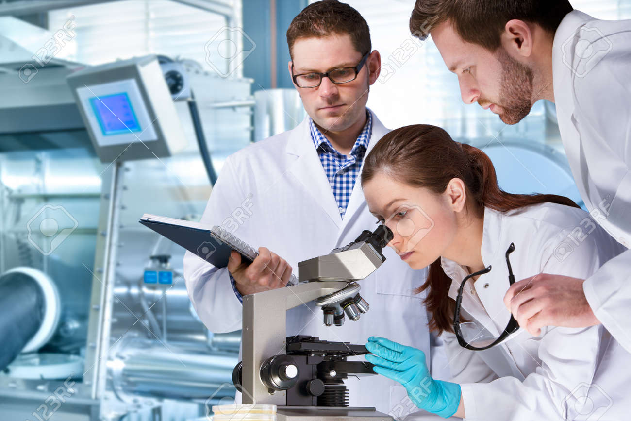 group of scientists working at the laboratory - 38495349