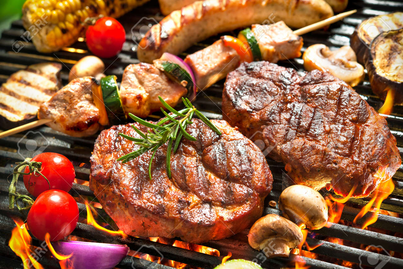 Assorted delicious grilled meat with vegetable over the coals on a barbecue Standard-Bild - 39490665