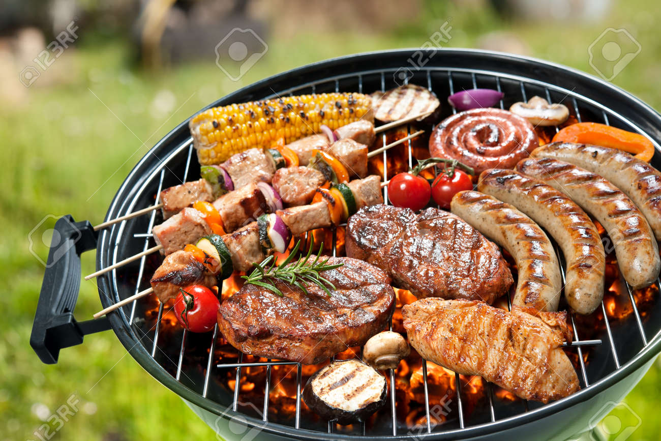Assorted delicious grilled meat with vegetable over the coals on a barbecue - 39490669