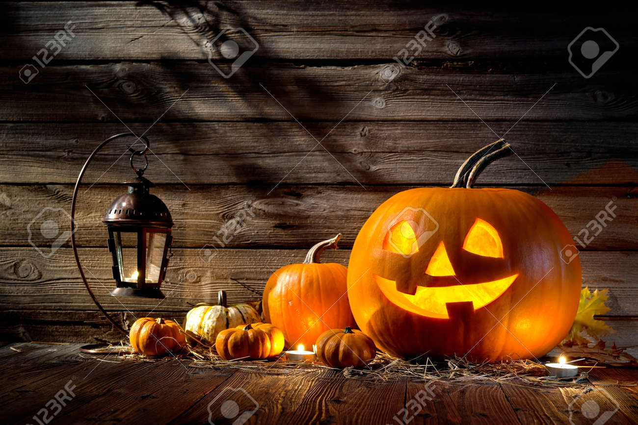 halloween pumpkin head jack lantern on wooden background stock photo - Spooky Halloween Pictures Free