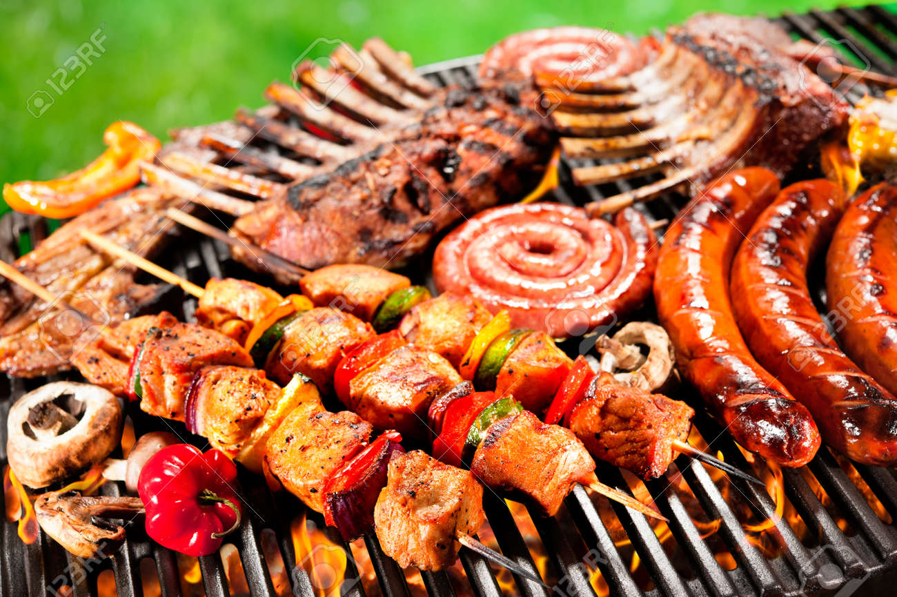 Assorted delicious grilled meat with vegetable over the coals on a barbecue - 40695099