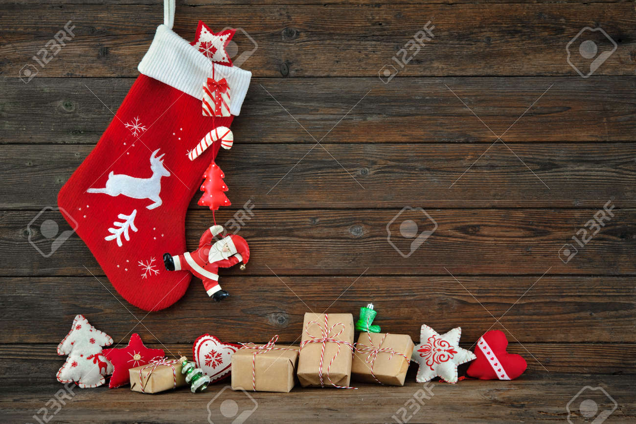 Christmas decoration stocking and toys hanging over rustic wooden background Stock Photo - 45991618