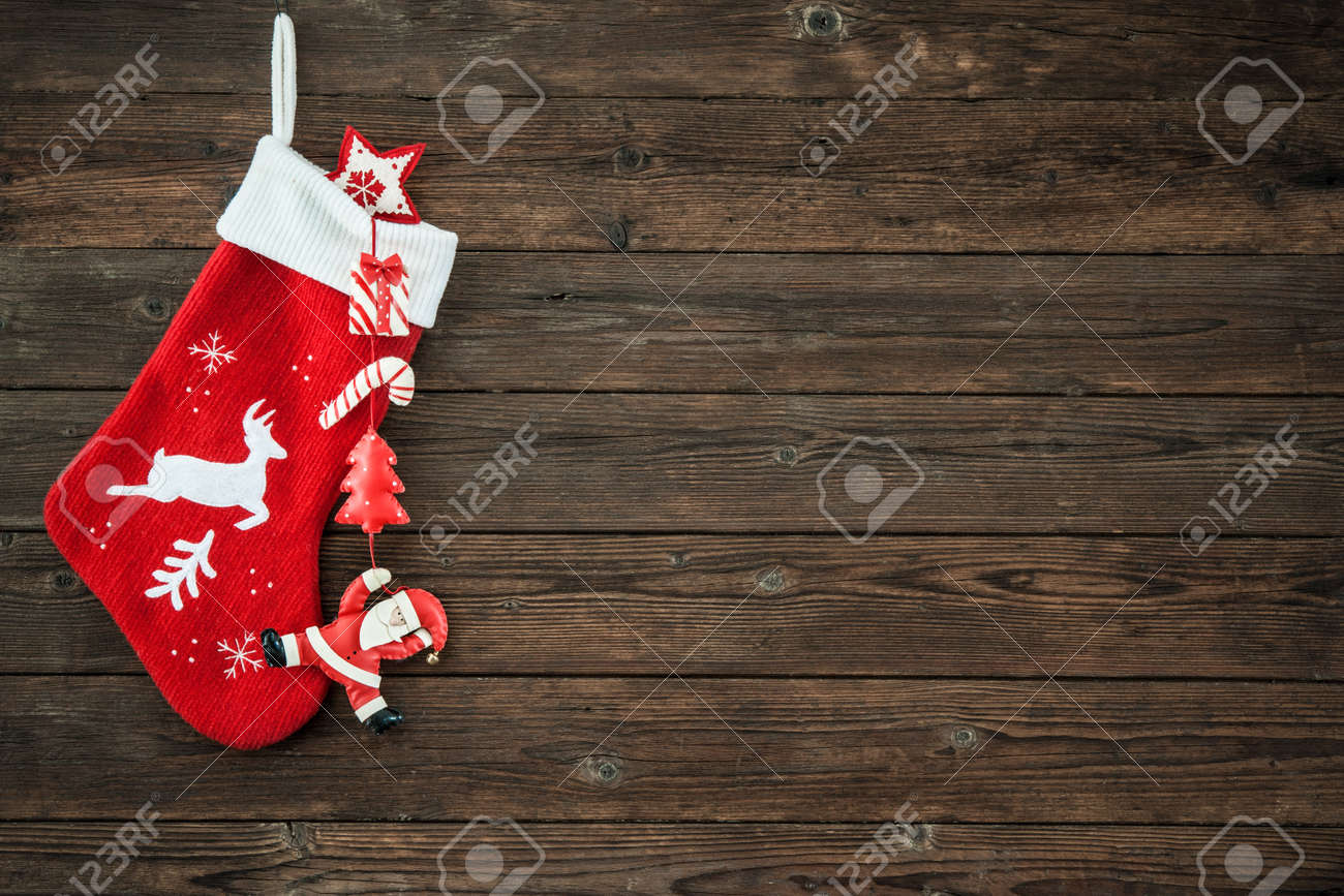 Christmas decoration stocking and toys hanging over rustic wooden background Stock Photo - 45991619