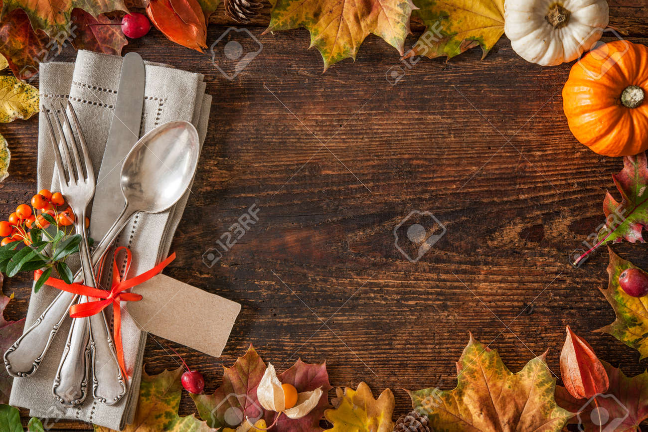 Thanksgiving autumn place setting with cutlery and arrangement of colorful fall leaves Stock Photo - 46735078