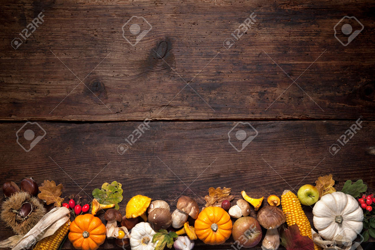 Harvest or Thanksgiving background with autumnal fruits and gourds on a rustic wooden table Stock Photo - 46735178