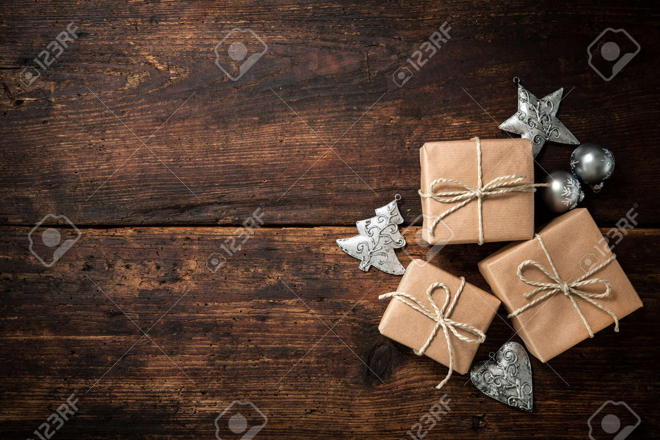 Christmas gift boxes and decoration over grunge wooden background Stock Photo - 47115121