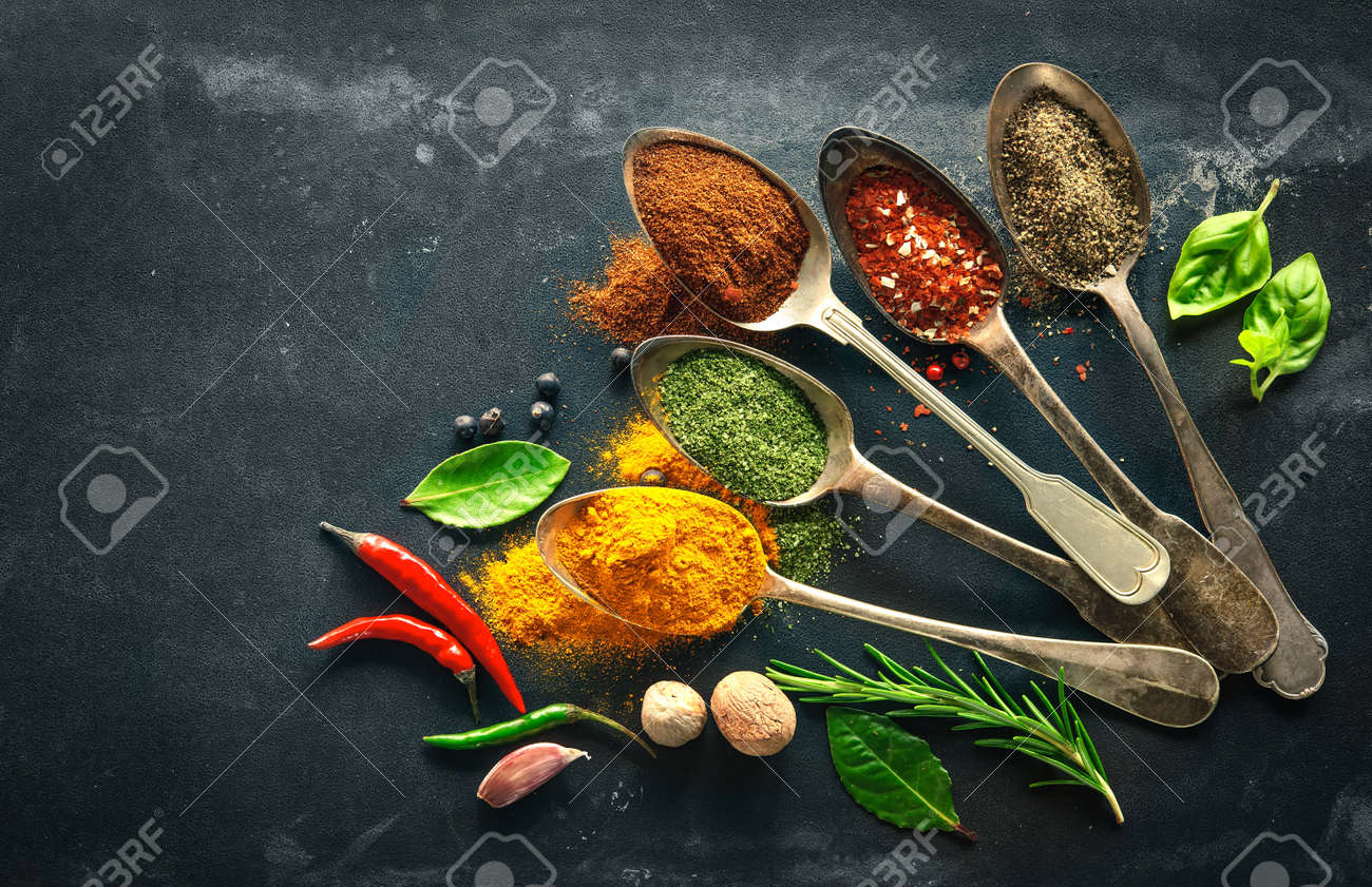 Various herbs and spices on black stone plate Stock Photo - 47115026