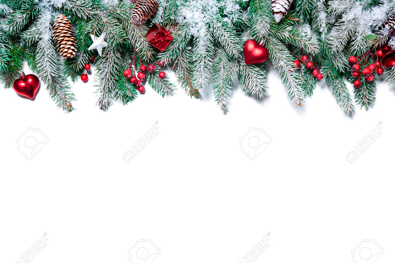 Christmas Border. Tree branches with baubles, stars, snowflakes isolated on white Stock Photo - 47115022