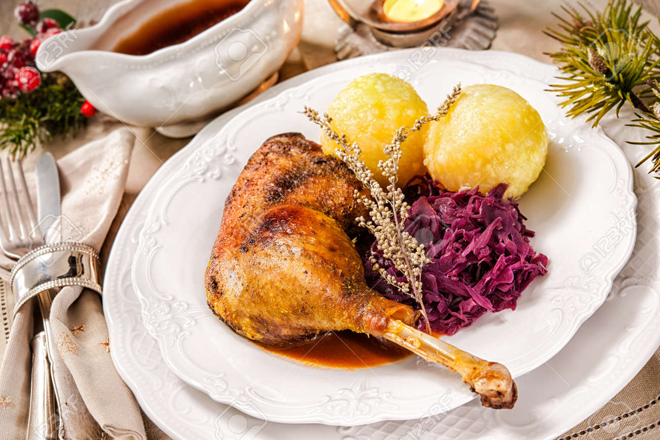 Crusty Christmas goose leg with braised red cabbage and dumplings Stock Photo - 47541751