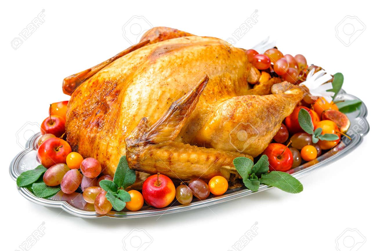 Garnished roasted turkey on platter over white background Stock Photo - 47929599