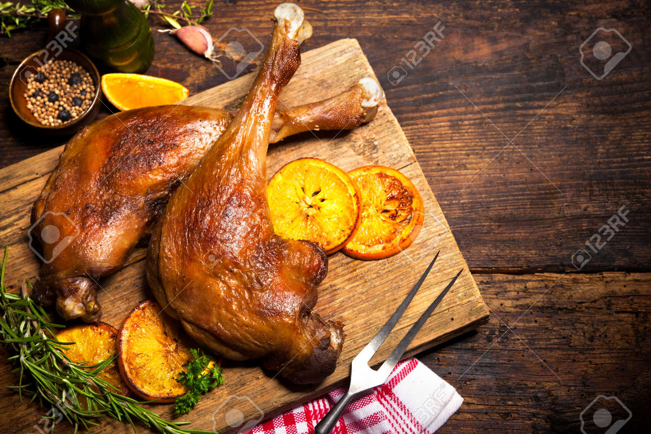 Roasted goose legs with oranges and spices. Cooking at Christmas time Stock Photo - 47929602