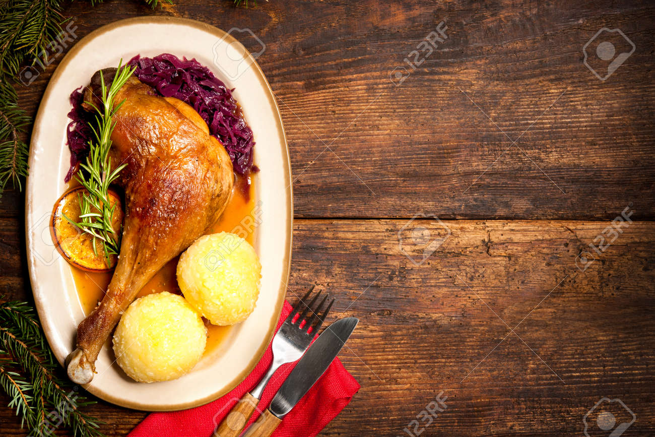 Crusty goose leg with braised red cabbage and dumplings. Cooking at Christmas time Stock Photo - 47929605