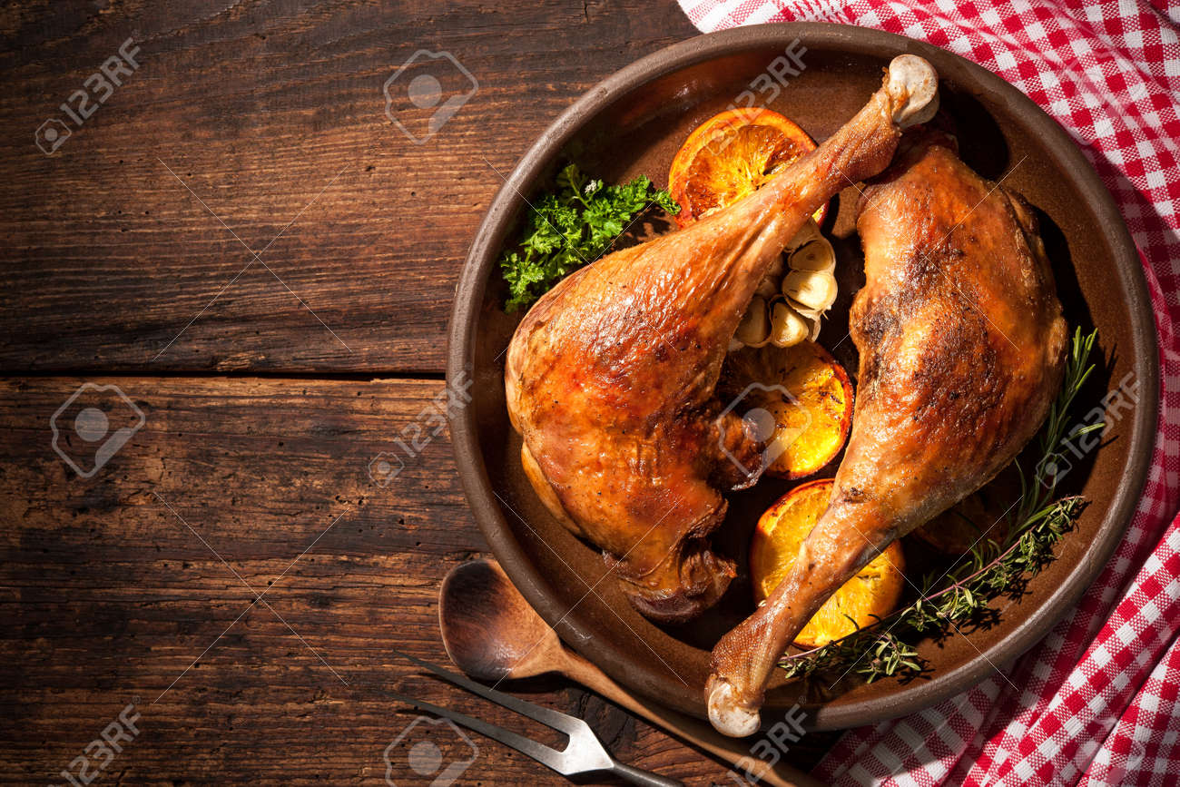 Roasted goose legs with oranges and spices. Cooking at Christmas time Stock Photo - 47931609