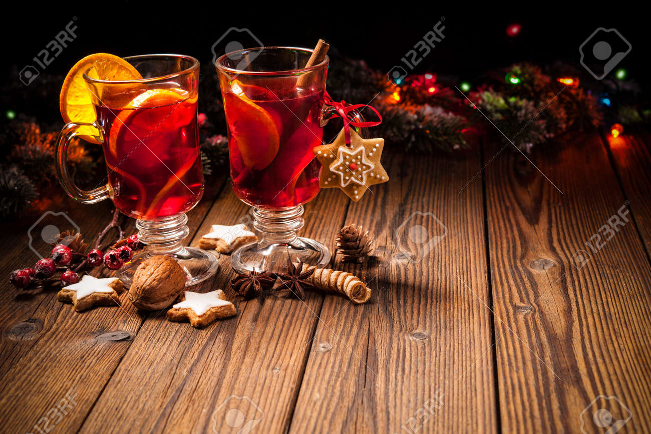Two glasses of hot mulled wine with oranges and spices Stock Photo - 47931689