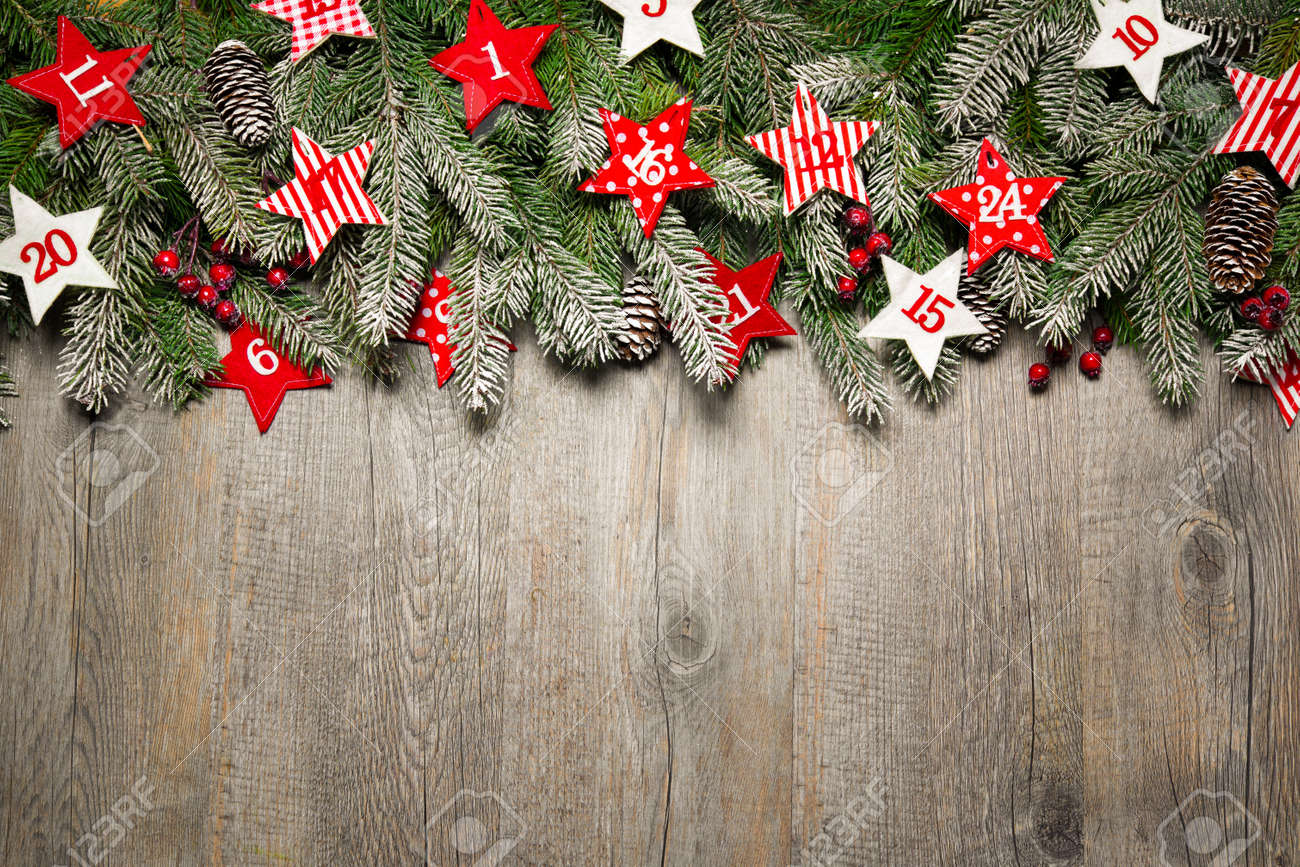 Fir tree  branches and advent calendar stars on old wooden board Stock Photo - 47931702