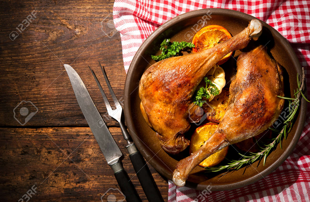 Roasted goose legs with oranges and spices. Cooking at Christmas time Stock Photo - 47931705