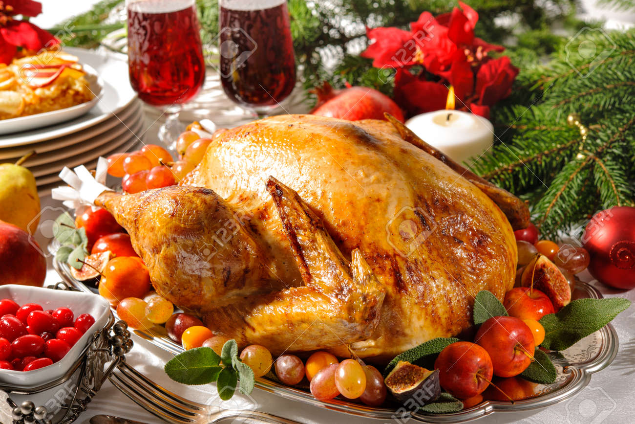 Roasted turkey on holiday table with candles Stock Photo - 48315021