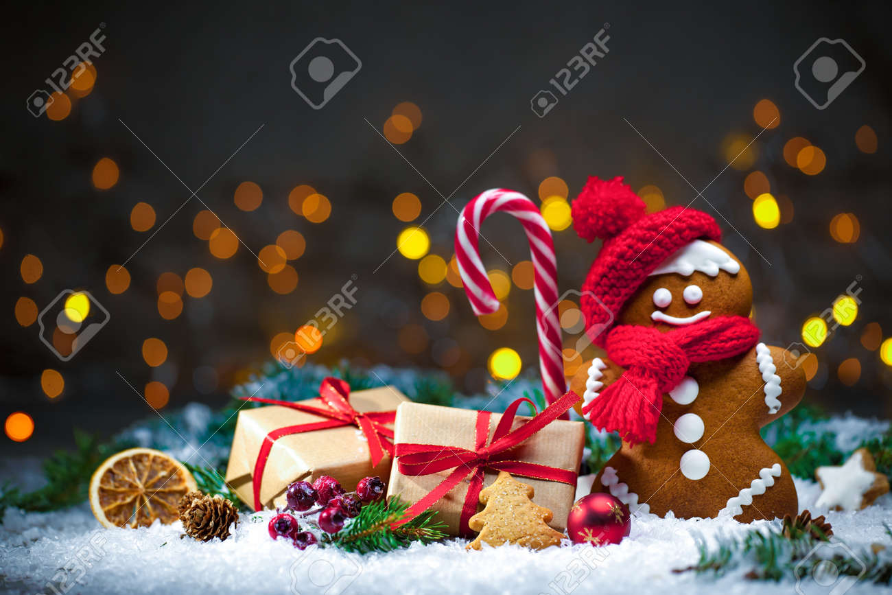 Gingerbread man with Christmas presents in snow Stock Photo - 48523723