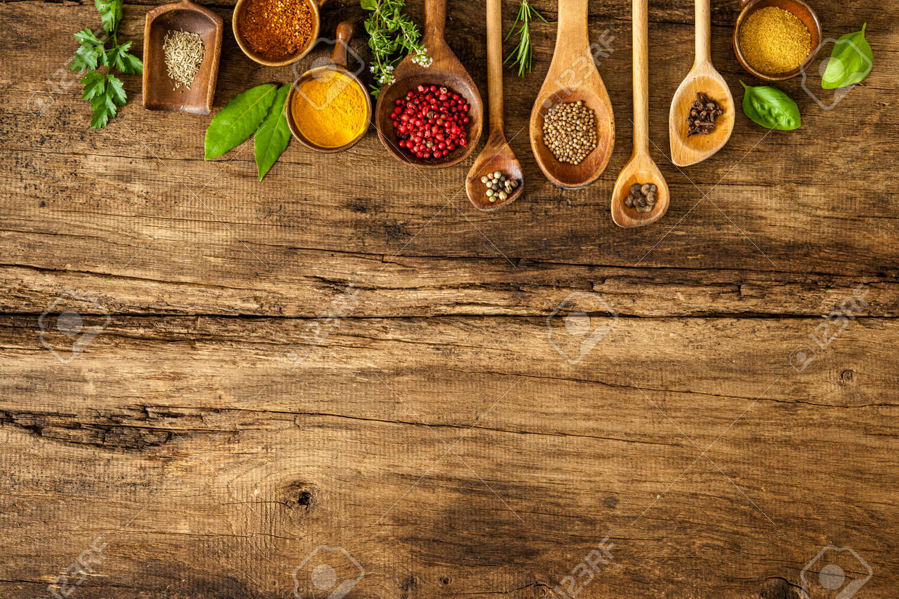 Various colorful spices on wooden table Stock Photo - 48523959