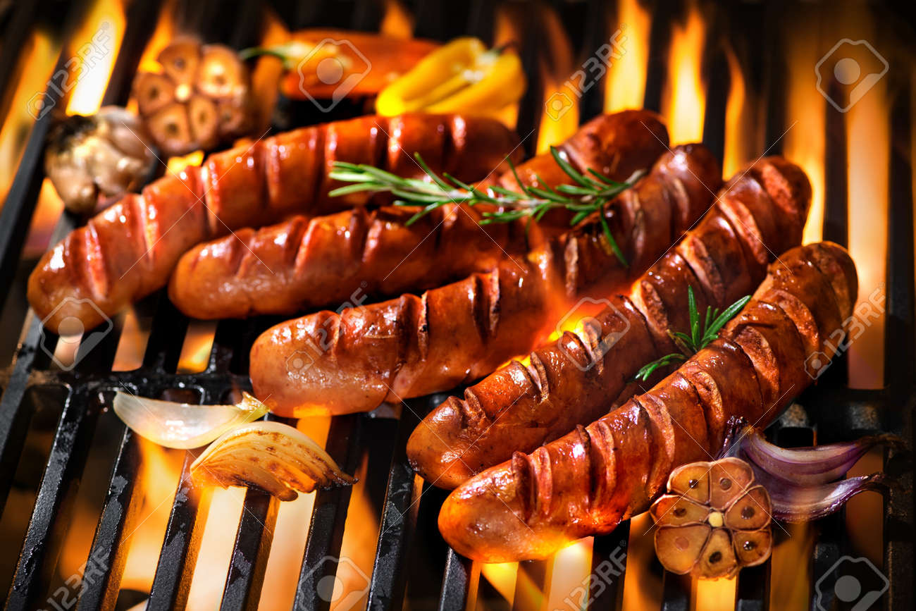 Grilled sausage on the flaming grill - 52914013