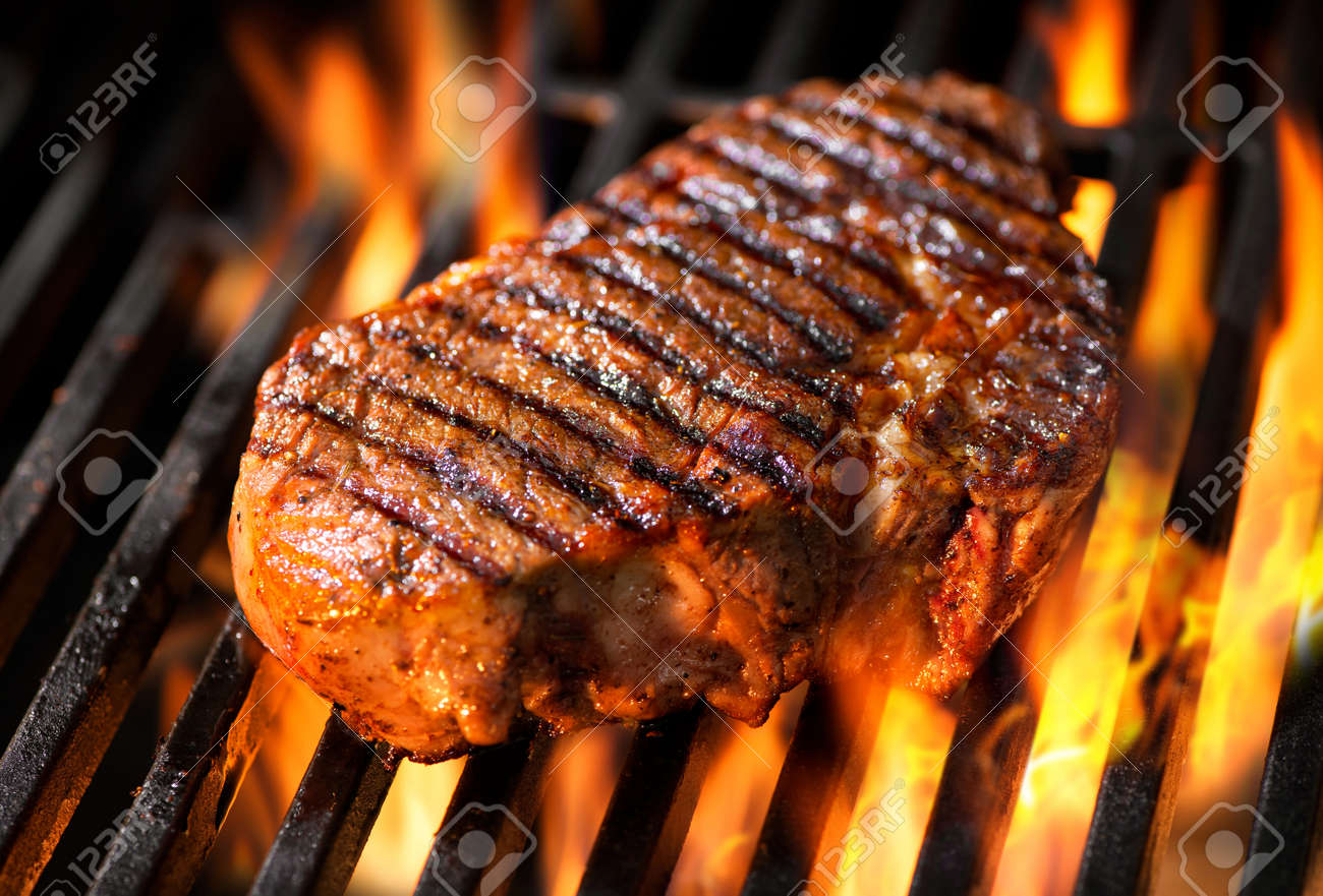 Beef steak on the grill with flames Stock Photo - 52914025