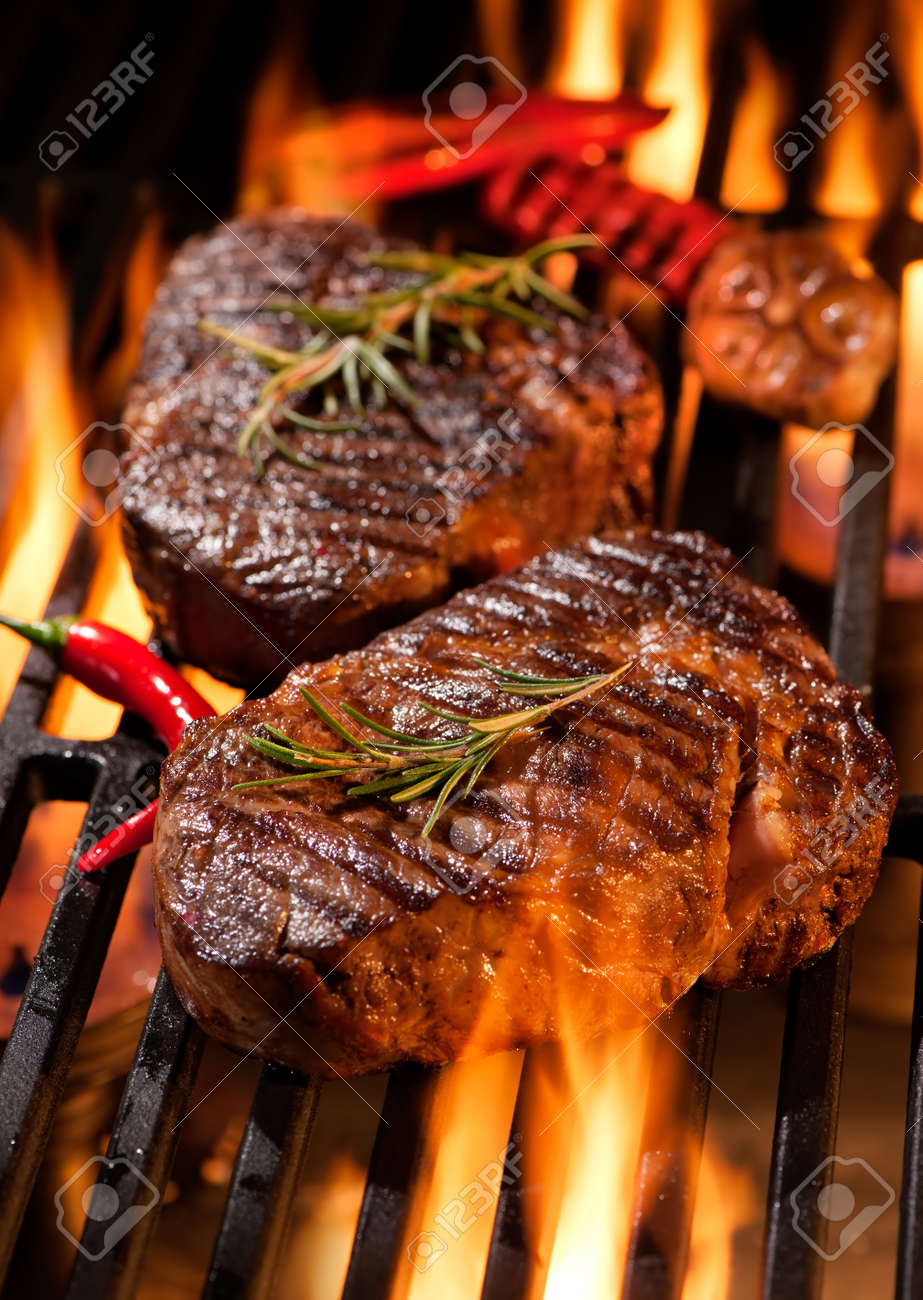 Beef steaks on the grill with flames Stock Photo - 52914010