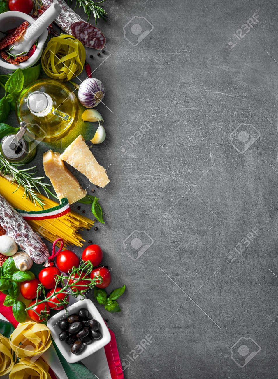Italian food ingredients on slate background - 56306720