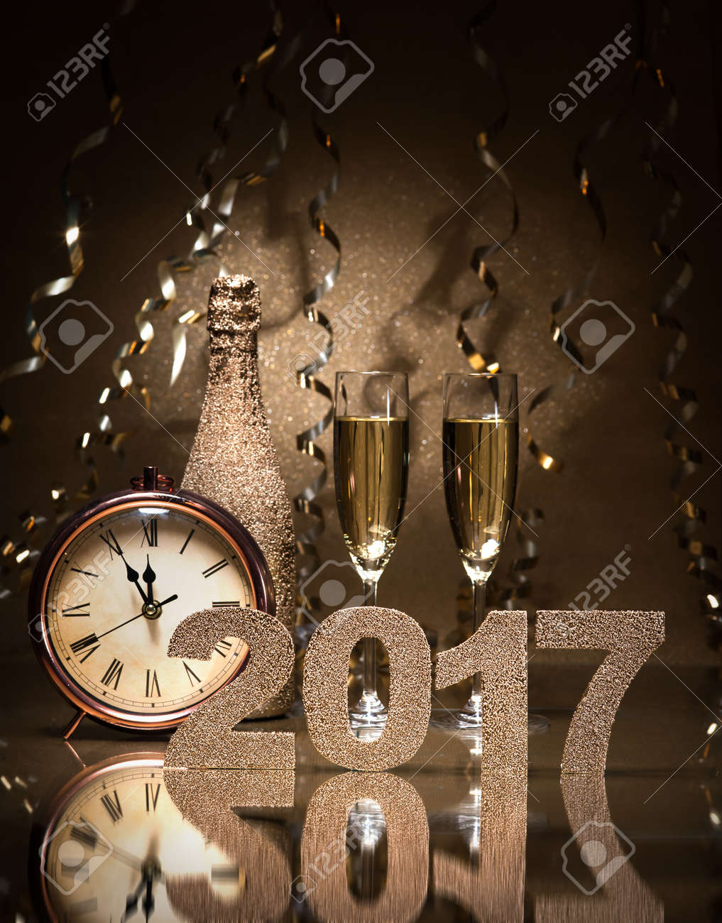 New Years Eve celebration background with pair of flutes, bottle of champagne and a clock Stock Photo - 57058876