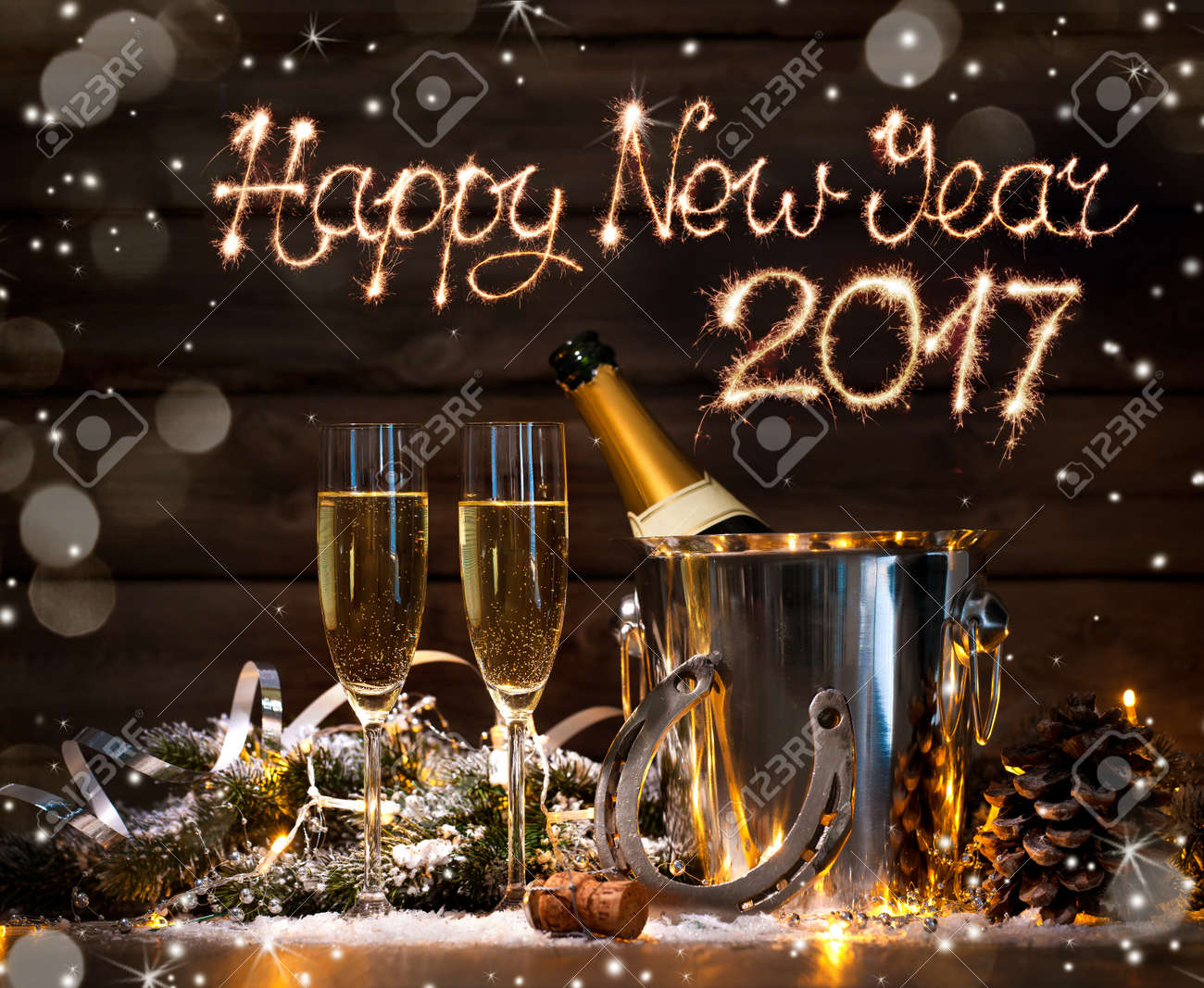 New Years Eve celebration background with pair of flutes and bottle of champagne in  bucket  and a horseshoe as lucky charm Stock Photo - 57247032