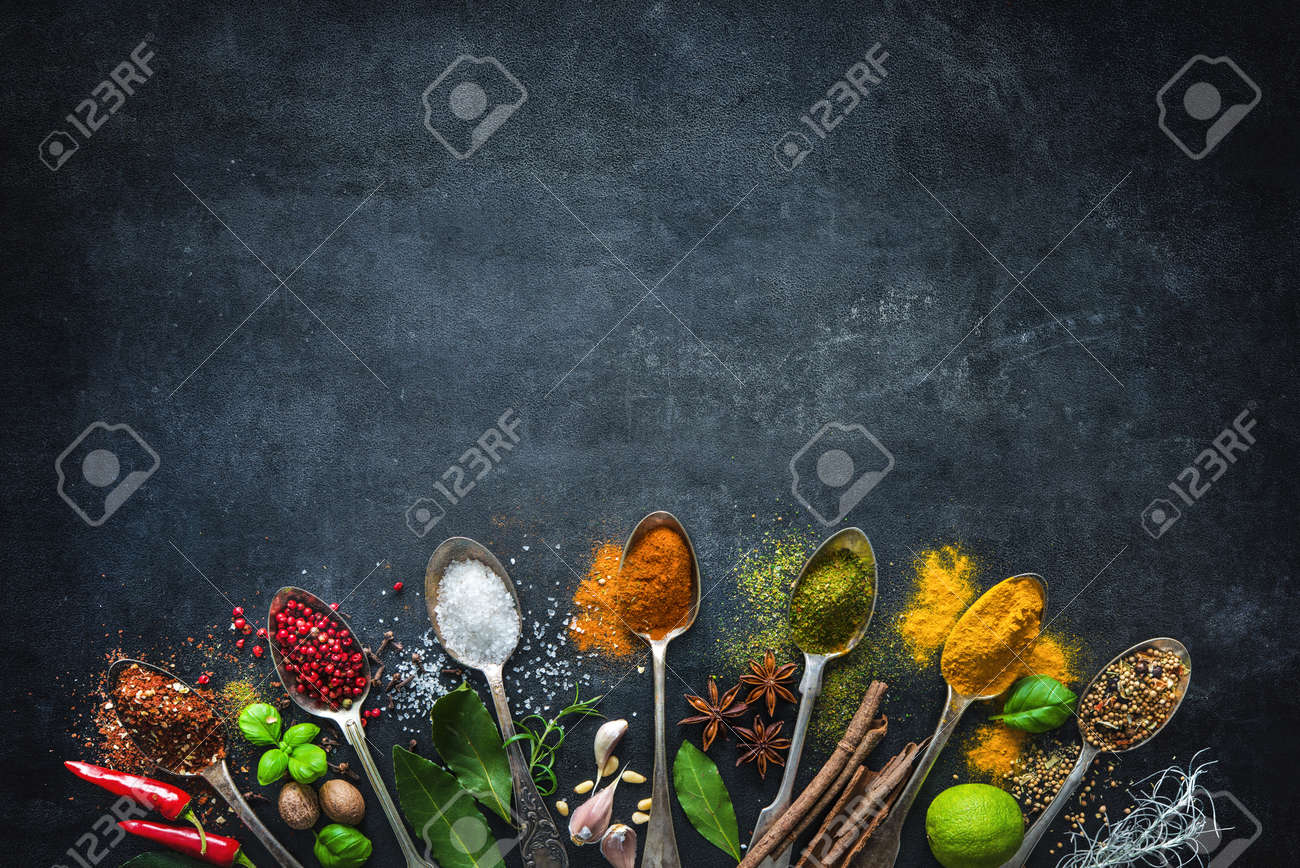 Various herbs and spices on black stone plate - 71882593