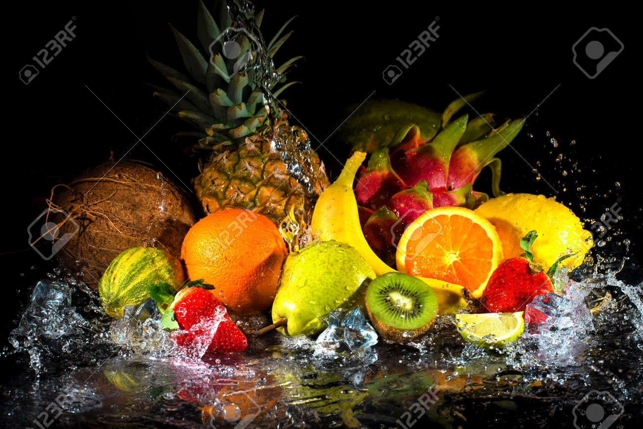 Fruits on black background with water splash - 73220482