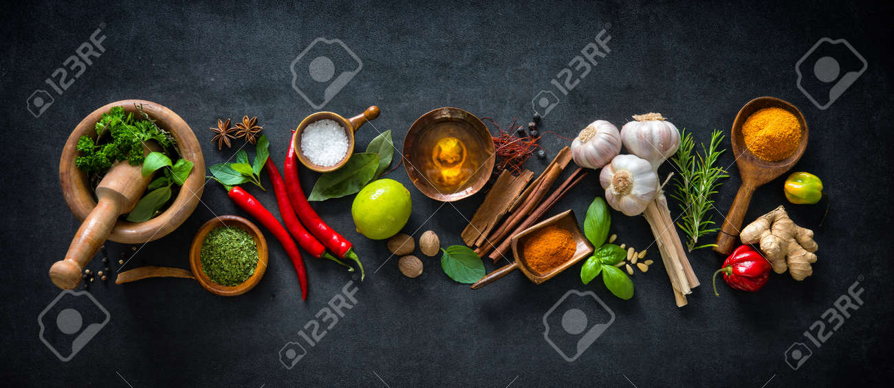Various herbs and spices on dark background - 80125690