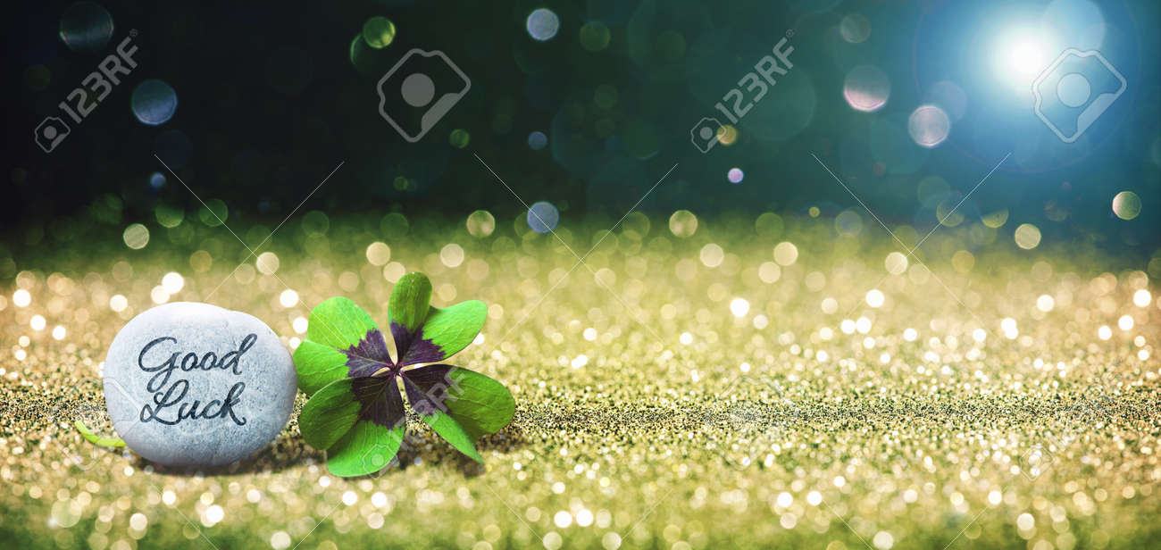 Abstract background with four leaf lucky clover and stone as copy space - 83368612