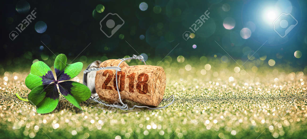 Happy New Year. Greeting card with four leaf clover and champagne cork - 83368613