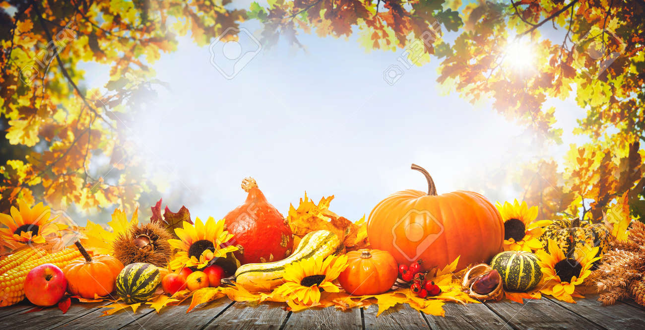 Thanksgiving background with pumpkins, wooden plank and falling leaves - 86540777