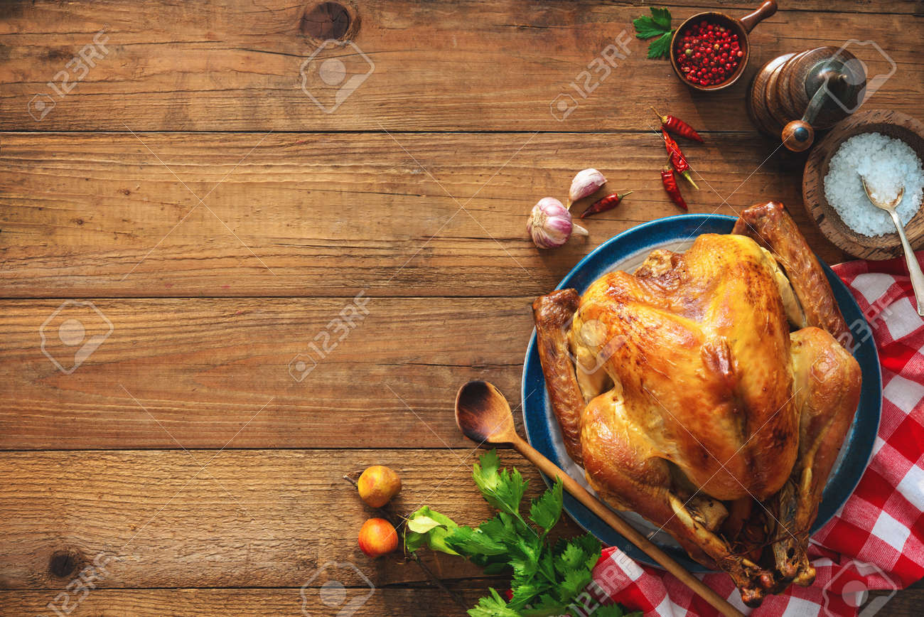 Christmas or Thanksgiving turkey on rustic wooden table - 87180628