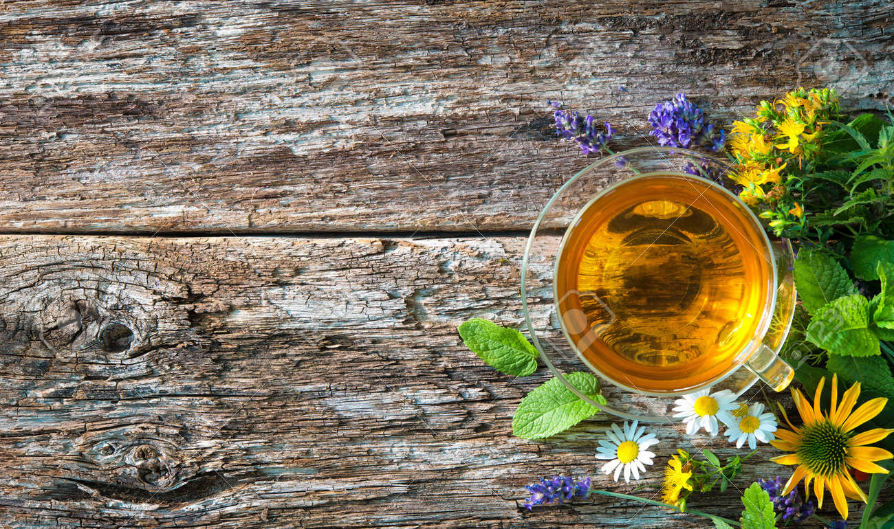 Cup of herbal tea on wooden table - 93210481