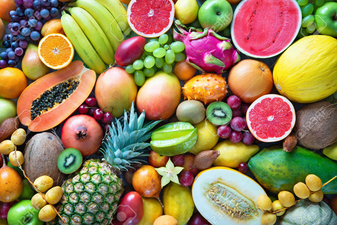 Food background. Assortment of colorful ripe tropical fruits. Top view - 104580621